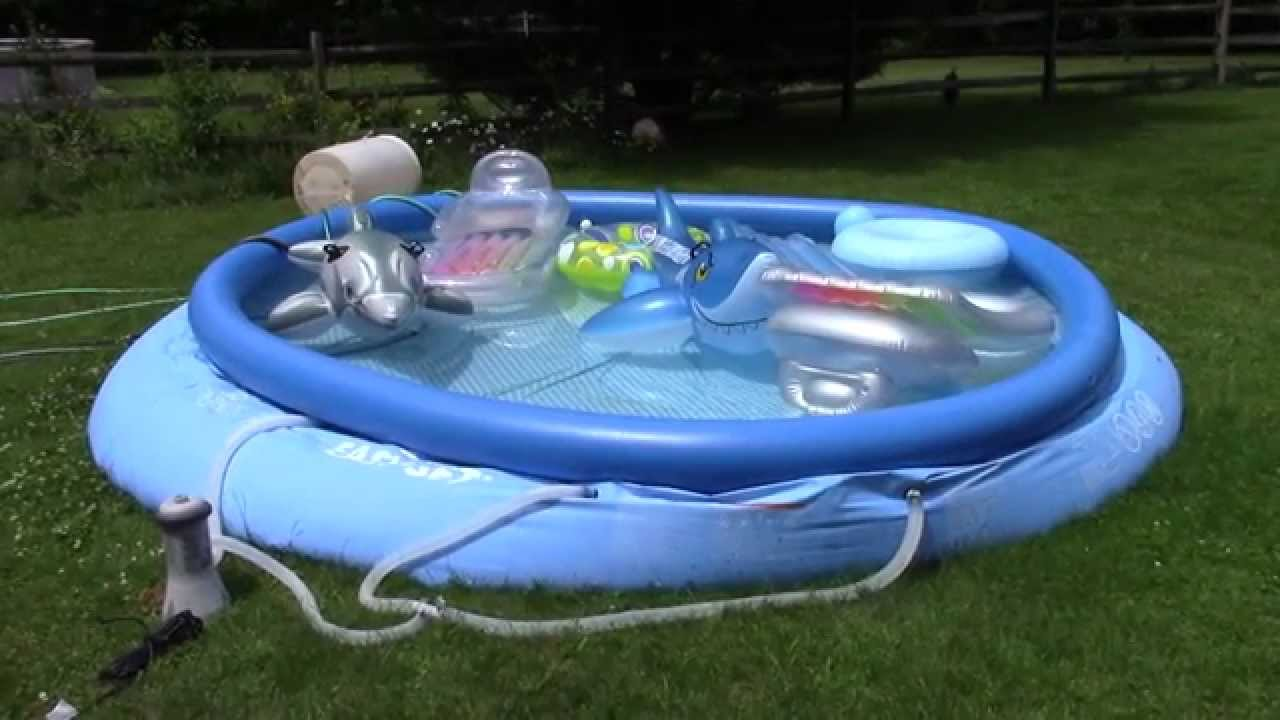 Quickly drain a swimming pool and keep water away from house youtube for How to drain a swimming pool with a hose