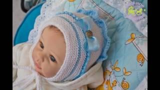 Шапочка и пинетки.Вязанный комплект для новорожденного