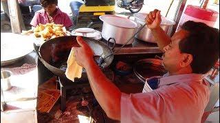 Indian Street Food: Punjabi Samosa + freshly fried Bhature with Chole & Palak Aloo, Bardoli, India.