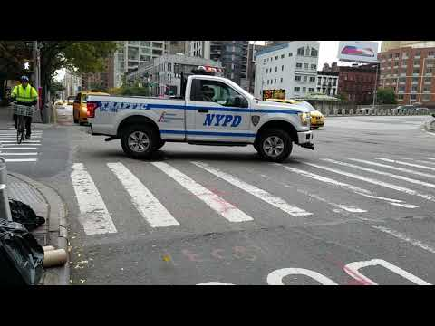 NYPD Traffic Enforcement Bronx Tow Roaming Around Midtown Placing Boots On Vehicles