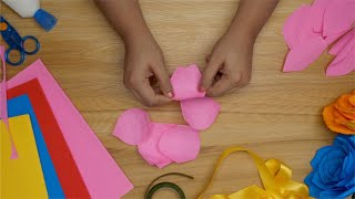 An Indian girl unfolding her paper cutouts to make a 3D flower