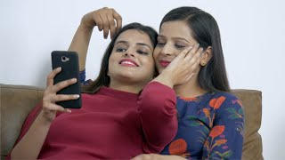 Indian LGBTQ couple watching videos on the phone while caressing each other