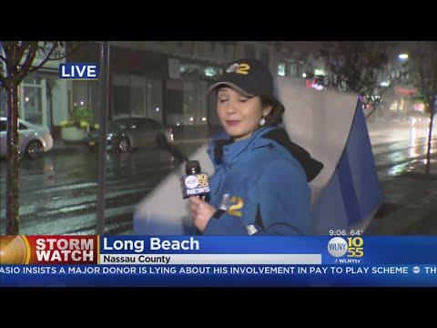Wind Sends Ali's Umbrella, Hat Flying