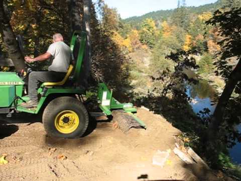 John Deere 755 With Rake Attachment