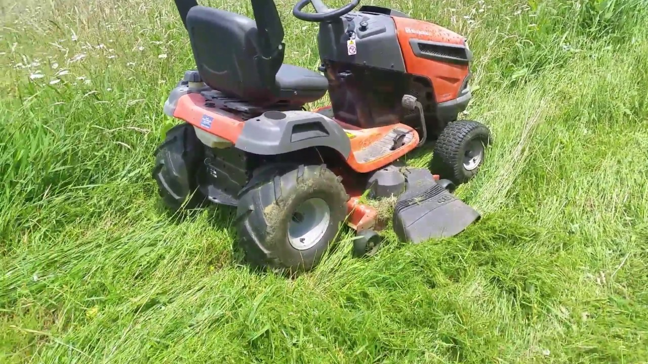 Husqvarna YTA24V48 One year later review  Mowing tall, wet grass with ATV  tires