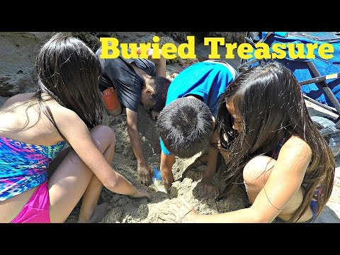 Toy Hunt Buried Treasure At Corona Del Mar Beach, California With Kids Searching For Pirate Treasure