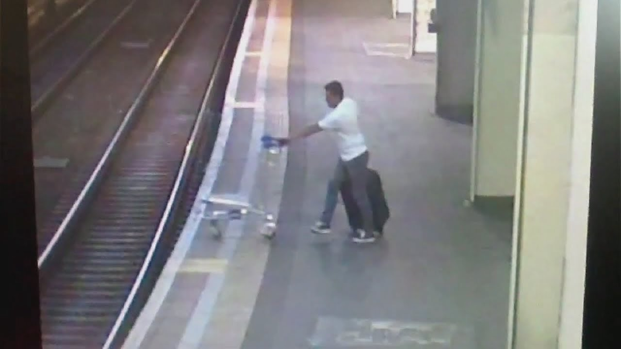 CCTV: Shocking moment train hits trolley that was deliberately pushed on tracks