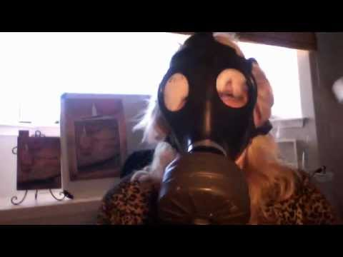 ROGUE PERFUMER wears a gas mask at her perfume table