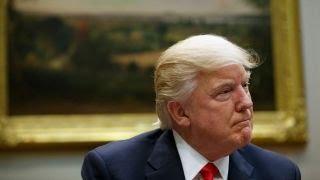Trump sued by 200 Democratic lawmakers