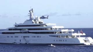 Helicopter landing on the (second) largest yacht in the world.