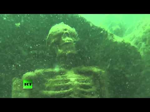 Underwater skeleton tea party 'art' display discovered at bottom of lake