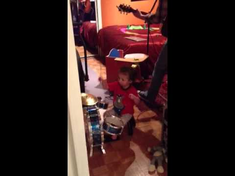 Chris Sullivan with his son Greyson on drums at 20 months old