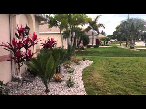 nw cape coral front yard landscape w white rock tropical plants youtube. Black Bedroom Furniture Sets. Home Design Ideas