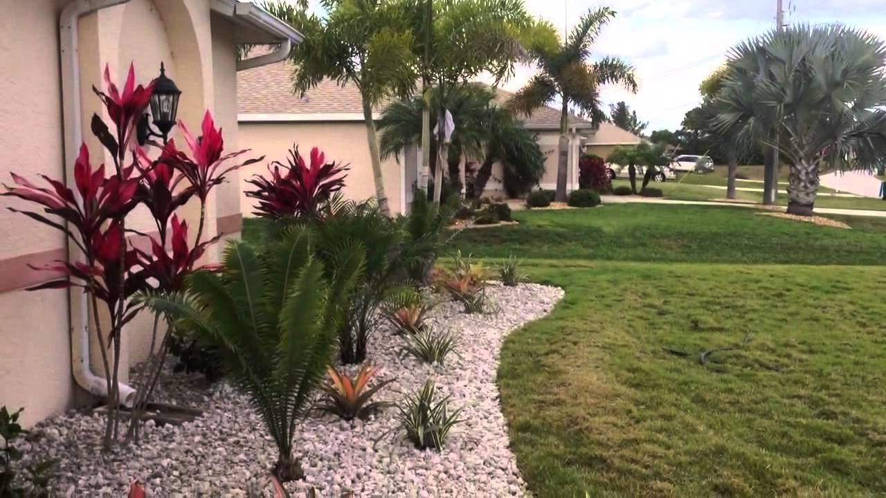Nw cape coral front yard landscape w white rock tropical plants