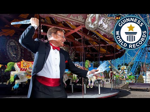 Most balloons burst with throwing knives in one minute  – Guinness World Records