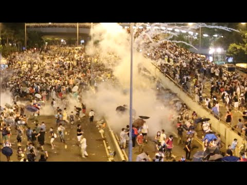 Hong Kong police fire tear gas at protesters outside government offices
