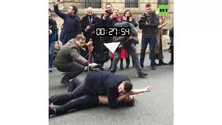 Erm, what is he doing? Is this the standard police procedure for arrests in France?