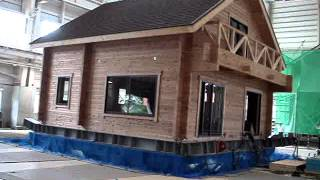 Log house on earthquake test