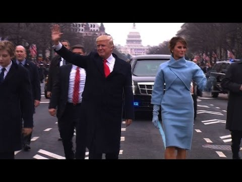 Trumps walk down Pennsylvania Avenue during parade