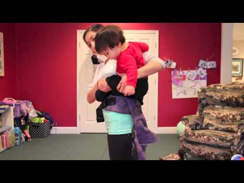 Ways of getting your baby toddler on your back for babywearing back carry using a Tula.