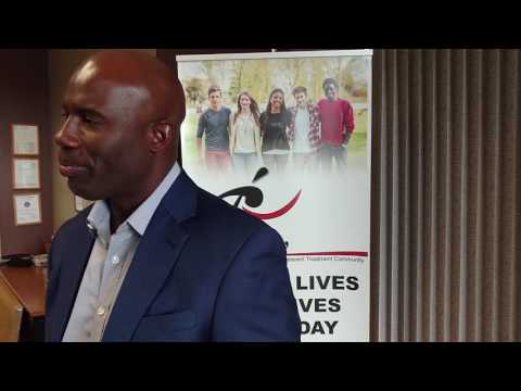 Terrell Davis visits with the El Pueblo Adolescent Treatment Community