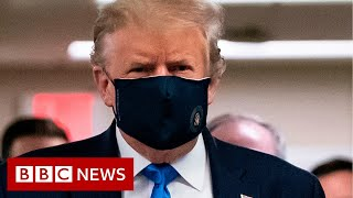 Coronavirus: Donald Trump finally wears mask in public - BBC News
