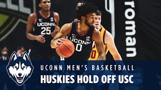 Uncasville, conn. – the uconn men's basketball team (3-0) picked up a hard-fought victory thursday night as they knocked off previously-undefeated usc tr...