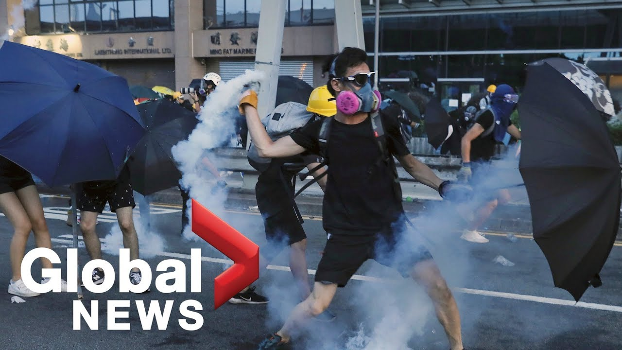 Hong Kong protests continue as police use tear gas to disperse crowds | LIVE
