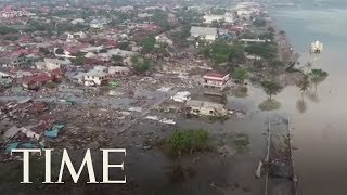 Video Drone Footage Shows The Devastating Aftermath Of The Tsunami In Palu, Indonesia | TIME download MP3, 3GP, MP4, WEBM, AVI, FLV November 2018