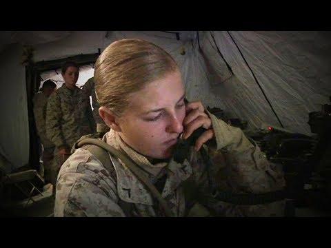 A Female Marine Working with a Radio