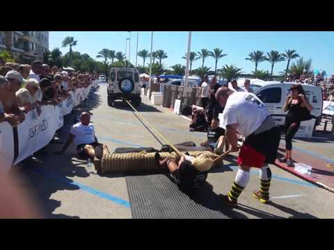 Strongwomen arm over arm truck pull