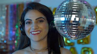 Closeup shot of a beautiful girl smiling with a mirror disco ball - party concept