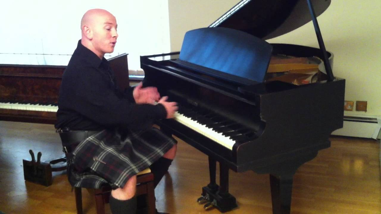 Small black challen baby grand piano demonstrated by for Small grand piano