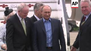 Russia President Putin and German Chancellor Merkel arrive for G8 summit