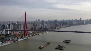SHANGHAI,Yangpu District, Aerial shot over Huangpu River with Yangpu Bridge and Shanghai skyline