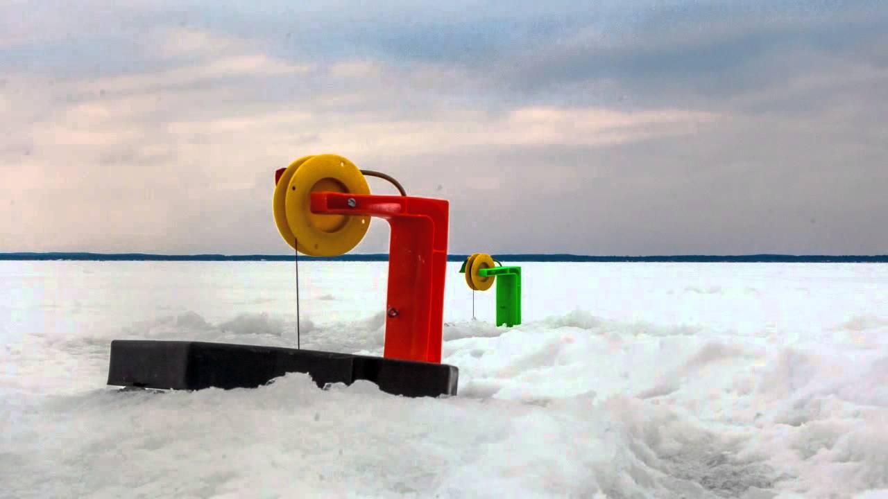 Great getaways ice fishing houghton lake mi youtube for Ice fishing michigan