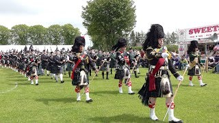 Massed pipes & drums parade for the opening of 2019 Oldmeldrum Highland Games in Aberdeenshire