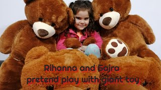 Rihanna and Sajra pretend play with giant toy