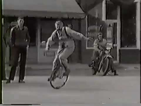1950 ca: 76 y.o. man performing bicycle tricks in Travelers Rest