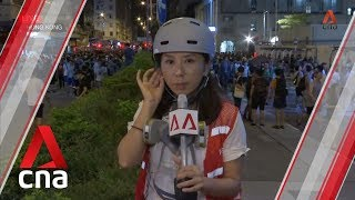 Protesters gather at police station after Hong Kong police arrest student