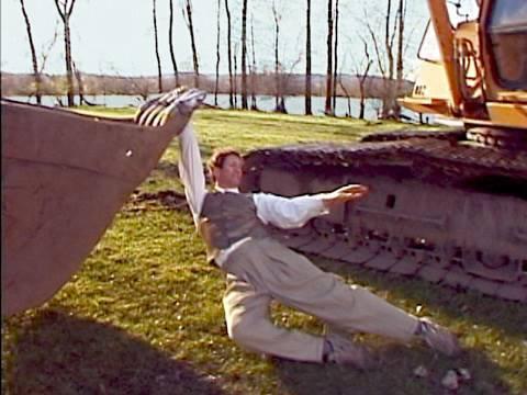 Man Romantically Dances with Excavator