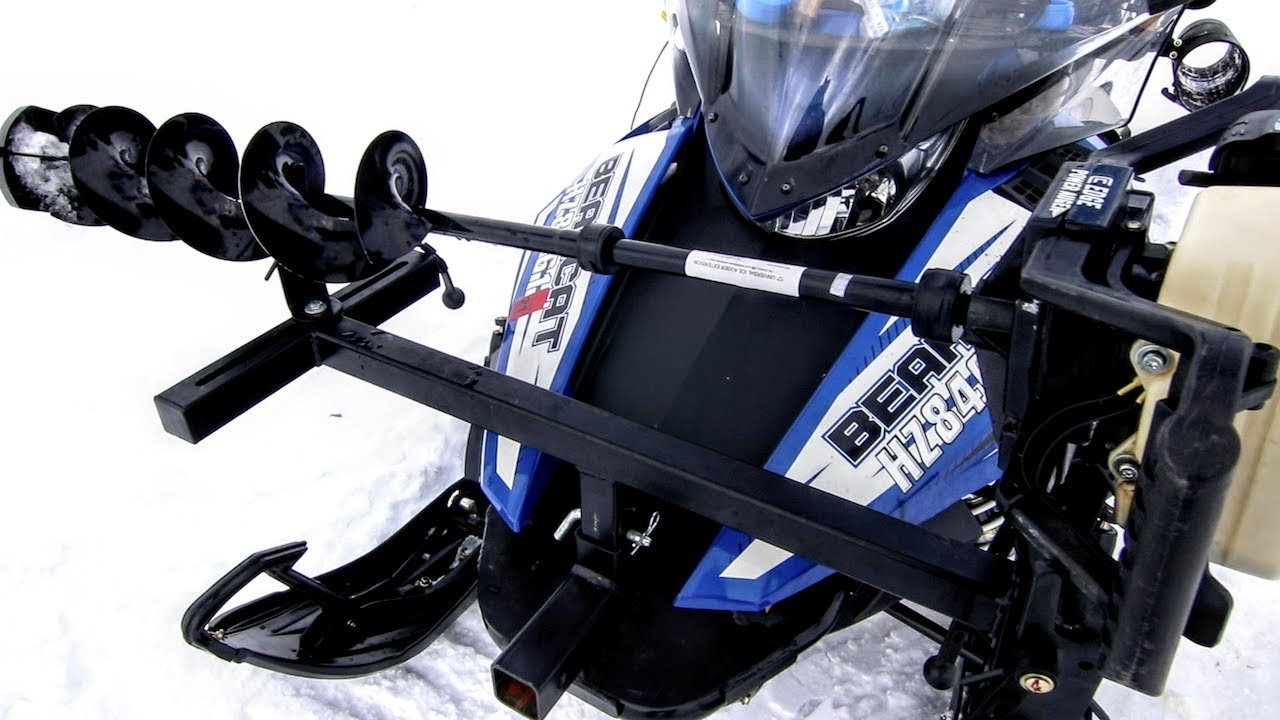tricked out snowmobile for ice fishing