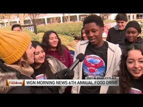 Gage Park High School students drop off donations at WGN Food Drive 2019