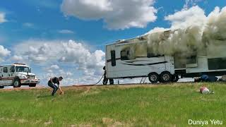 Burning RV trailer on HWY 2 in Alberta