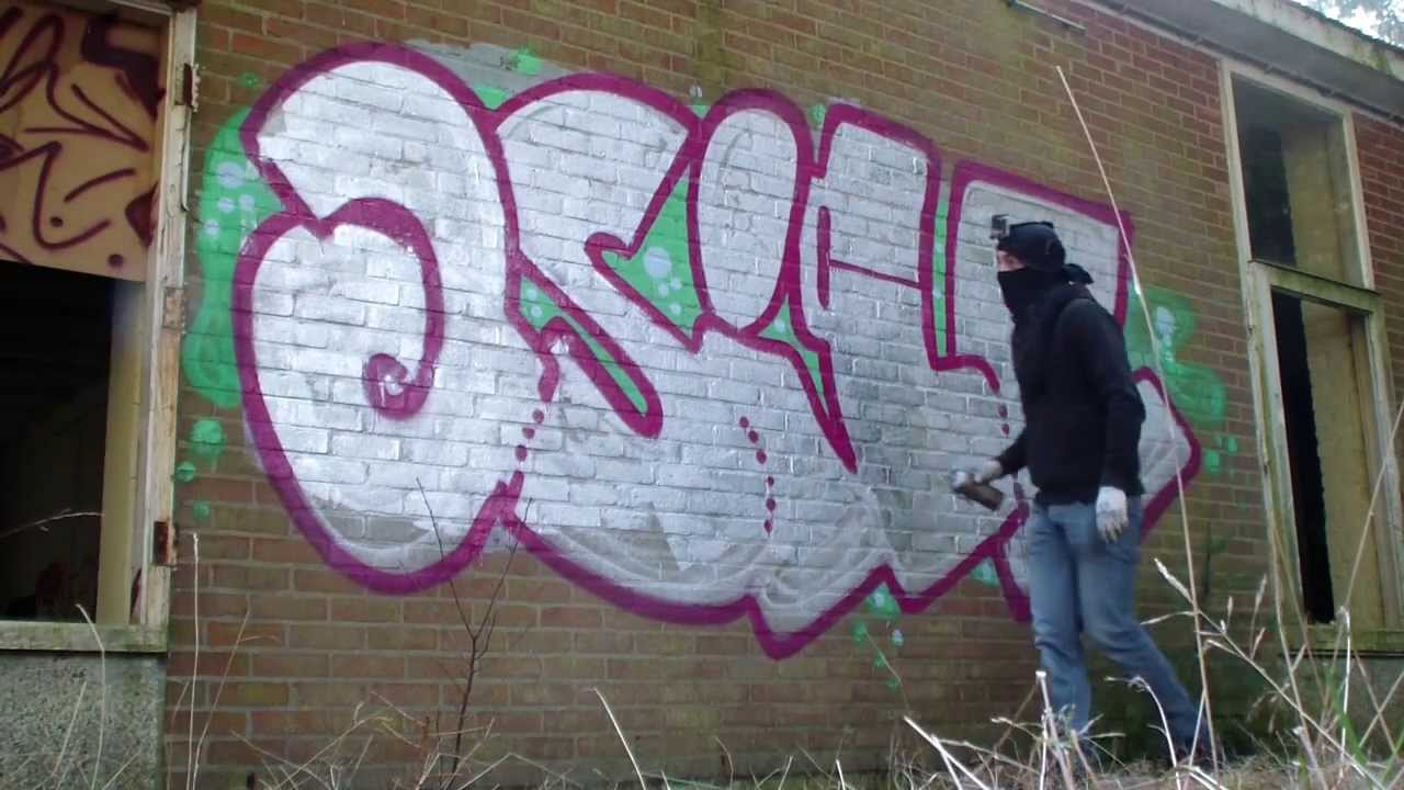 Graffiti Bombing Outside Abandoned Building