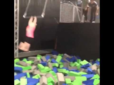 Girl slams into wall while swinging!