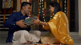 Diwali celebration at home - Brother giving a gift to sister, hug and kisses her