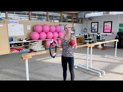 Barre exercises using a ball and Pilates ring