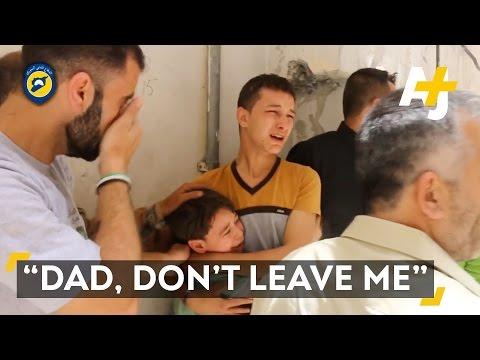 Child Cries Over His Father's Death In Aleppo