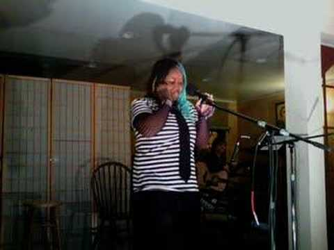 Skittlez singing acapella at the Coffee Club open mic